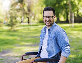 person in a park, smiling