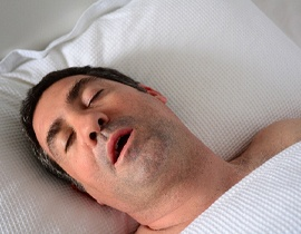 A man asleep with his mouth open