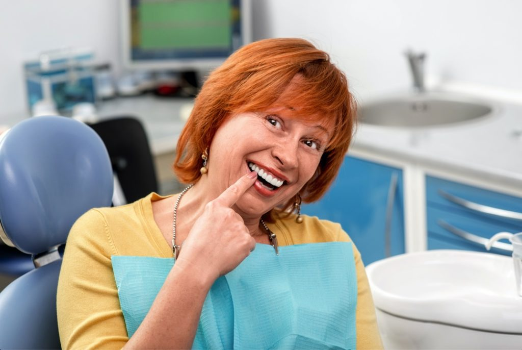 Woman with dental implants from Reno